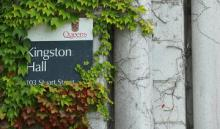 Kingston Hall sign framed by vines