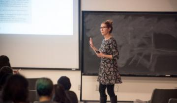 A teacher presenting a lecture to her class