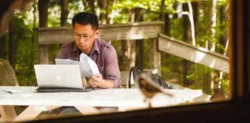 A man working on his dissertation outside